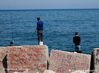 Men fishing on the Tyrrhenian Sea in Palermo, Sicily