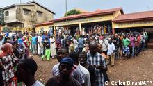 Guineans line up to vote in Sunday's presidential election (Cellou Binani/AFP)