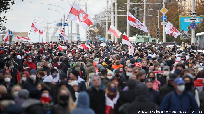 Belarusian opposition supporters stage an unauthorized rally in Minsk on October 18, 2020