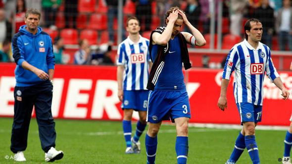 Friedrich holds his head after Hertha loss