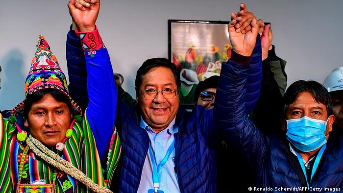 A picture of Bolivia's leftist president Luis Arce celebrating with his running mates after he won the first round of voting in October 2020.