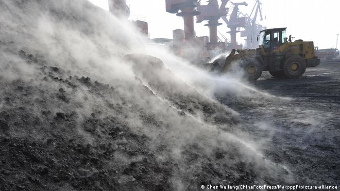 A shovel works with the coal imported from Australia at a Chinese port