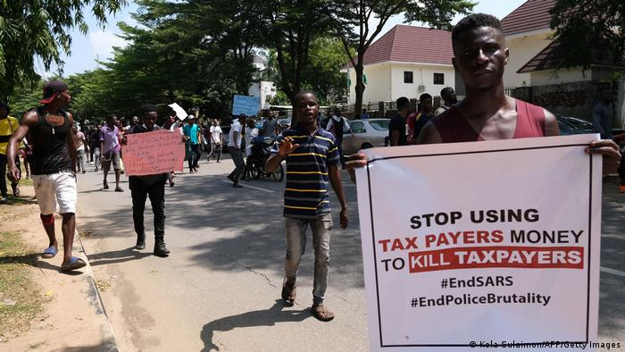 Protesters carry banners during a demonstration to press for the scrapping of Special Ant-Robbery Squad (SARS) in Abuja
