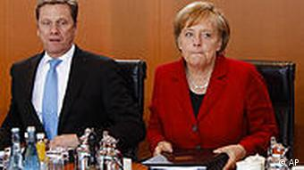 German Chanceller Angela Merkel, right, with Foreign Minister Guido Westerwelle in a cabinet meeting