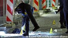 Police placing markers at the site of the attack (Roland Halkasch/dpa/picture-alliance)