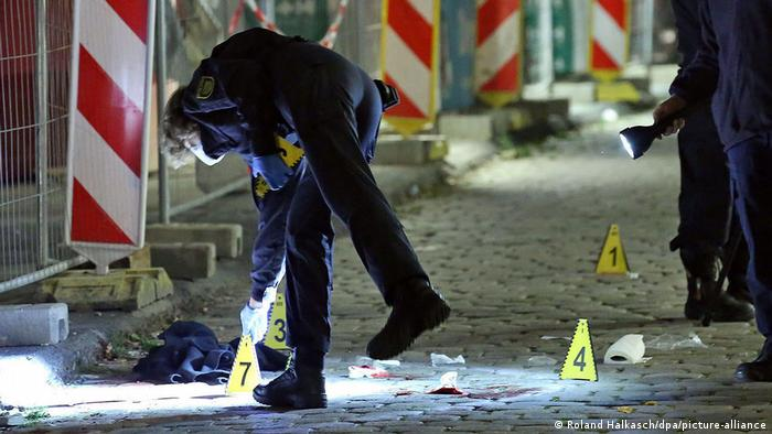 Police placing markers at the site of the attack
