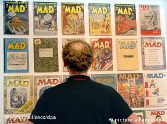 A man looks at a display of historical MAD magazine at the comics exhibition in the Jewish Museum in Berlin