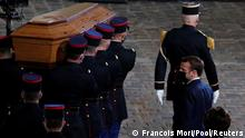 Pole bearers carry the coffin with the body of murdered teacher Samuel Paty (Francois Mori/Pool/Reuters)