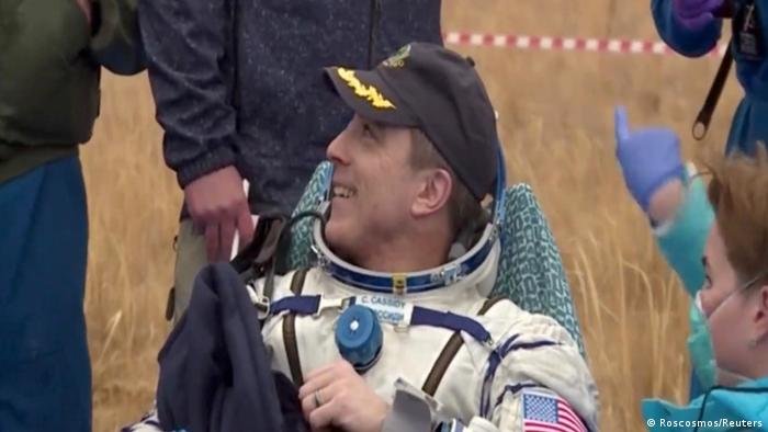 Astronaut Chris Cassidy greets people after leaving the space capsule