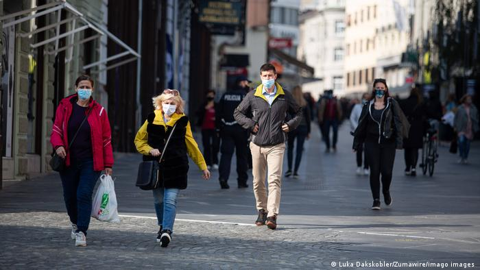 People wearing face maks in Ljubljana