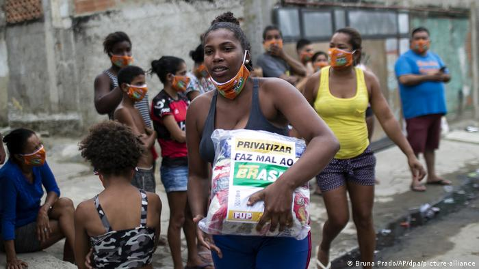 Brazil: A woman carries free food on a street in Rio de Janeiro. Picture: dpa