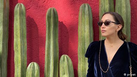 Student Valentina Sanchez stands in front of cactii