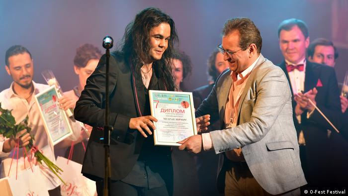 Student Mehran Mirmiri at the O-Fest Festival in Ukraine being handed an award