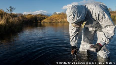 An expert inspects waters around Kamchatka that could be affected by pollution (Dmitry Sharomov/Greenpeace Russia/Reuters)