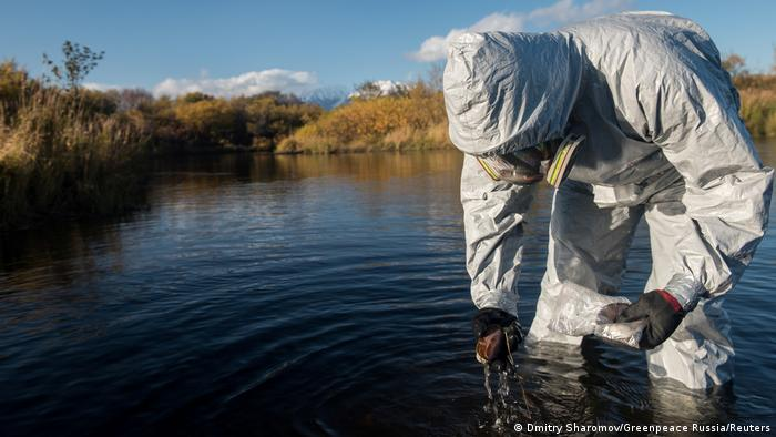 An expert inspects waters around Kamchatka that could be affected by pollution