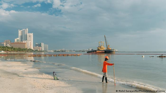 A government worker seen inside the newly opened rehabilitated portion of Manila Bay