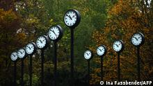 Art installation featuring clocks in Dusseldorf (Ina Fassbender/AFP)