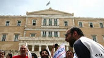 Pro-communist protesters shouting slogans in front of the parliament building in Athens