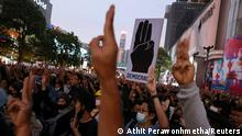 Thai protesters make a three-finger salute (Athit Perawonhmetha/Reuters)