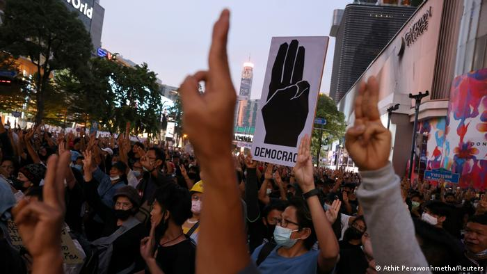 Thai protesters make a three-finger salute