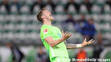 WOLFSBURG, GERMANY - OCTOBER 25: Wout Weghorst of Vfl Wolfsburg reacts during the Bundesliga match between VfL Wolfsburg and DSC Arminia Bielefeld at Volkswagen Arena on October 25, 2020 in Wolfsburg, Germany. A limited number of spectators will be in attendance as Covid-19 pandemic restrictions are eased in Wolfsburg. (Photo by Boris Streubel/Getty Images)