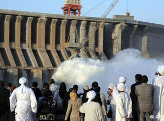 Sudanese and foreign tourists looking at the Merowe hydroelectric dam
