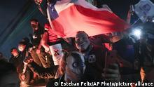 People gather at Plaza Italia on the day Chileans voted in a referendum to decide whether the country should replace its 40-year-old constitution, written during the dictatorship of Gen. Augusto Pinochet, in Santiago, Chile, Sunday, Oct. 25, 2020. (AP Photo/Esteban Felix) |