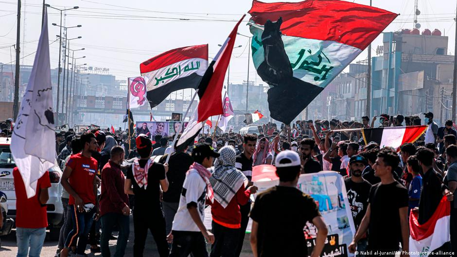 Protesters and police clash as thousands mark one year of Iraq demonstrations
