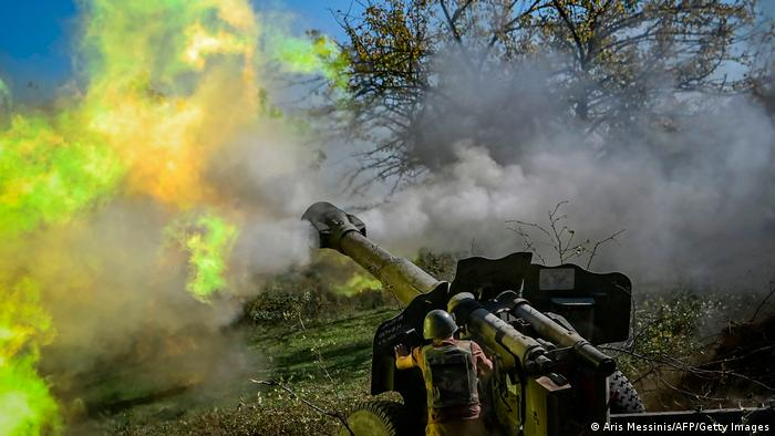 An Armenian soldier fires artillery on the front line on October 25, 2020, during the ongoing fighting between Armenian and Azerbaijani forces
