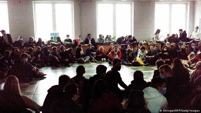 Students of Belarusian State University in Minsk sit on the floor as they take part in a nationwide strike in Minsk, on October 26, 2020.