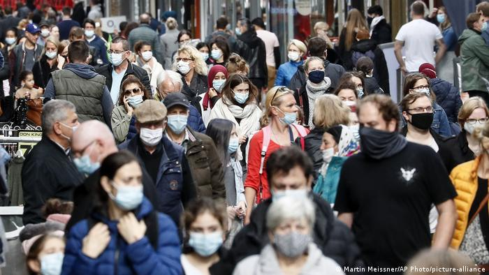 Shoppers in Cologne, Germany, wearing face masks