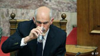 Greek Prime Minister George Papandreou drinks water during the Parliament meeting in Athens