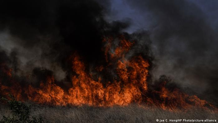 A fast moving wildfire burns near Irvine, CA