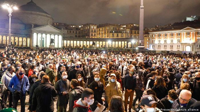 A crowd in Naples protests coronavirus restrictions