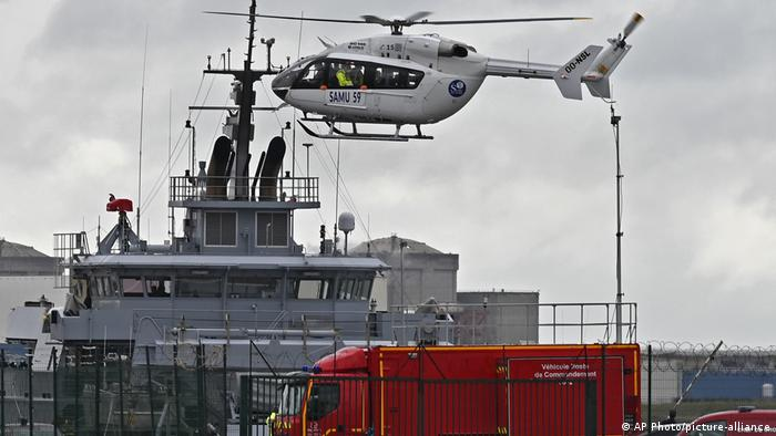 A French rescue helicopter lands close to a rescue vessel in Dunkirk, northern France, Tuesday, Oct. 27, 2020 during the search operation.