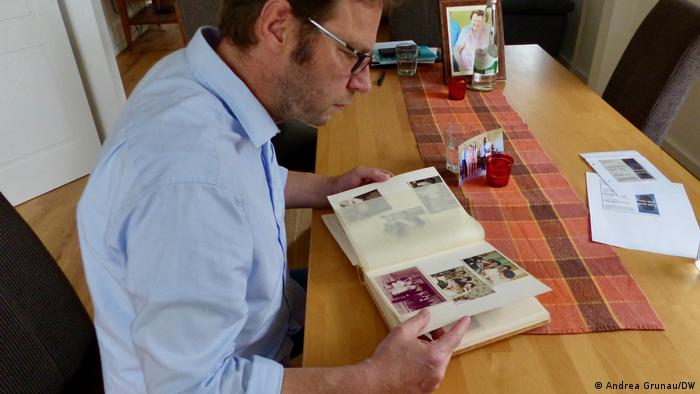 Detlev Jacobs looking at a photo album