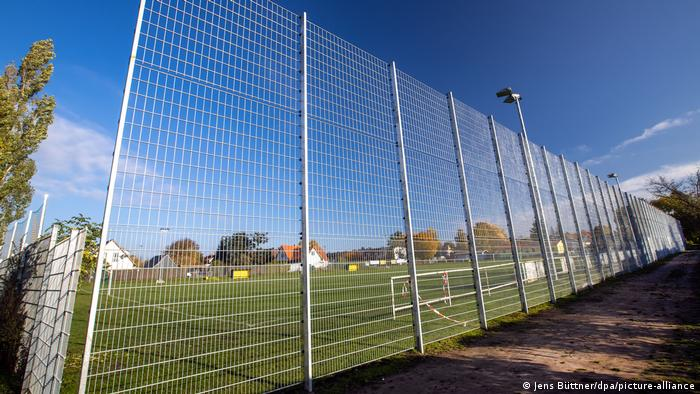 A ball-blocking fence at a sport field complex in Schwerin, Germany
