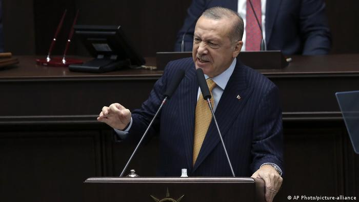 Turkey's President Recep Tayyip Erdogan addresses his ruling party lawmakers
