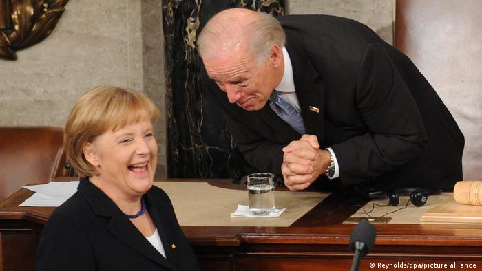 Angela Merkel laughing at something Joe Biden says (Reynolds/dpa/picture alliance )