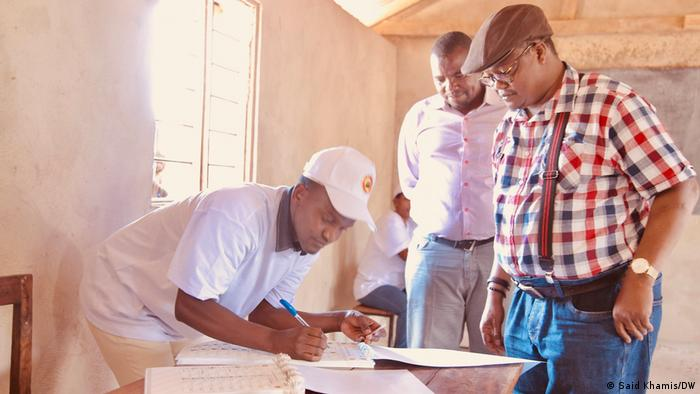 Presidential candidate Tundu Lissu casts his vote at a polling station