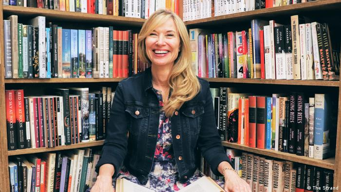 Nancy Bass-Wyden, owner of The Strand, photographed in front of a bookshelf