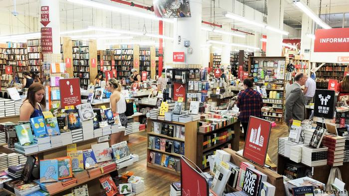 People browse books inside The Strand bookstore in New York City