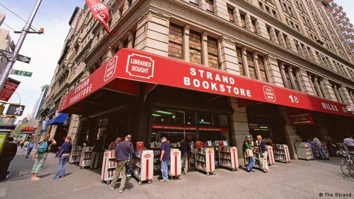 People stand in a line outside the New York City bookstore, The Strand