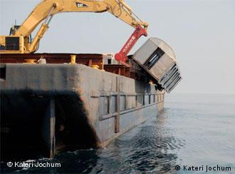 Image of a A New York subway car being dumped into the Atlantic Ocean.