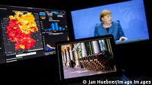 Angela Merkel onscreen announcing the new coronavirus measures