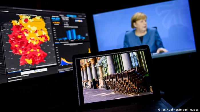 Angela Merkel onscreen announcing the new coronavirus measures