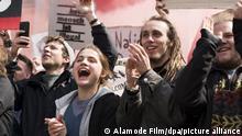 Film still 'And Tomorrow the Entire World' depicting young people smiling at a demonstration (Alamode Film/dpa/picture alliance)