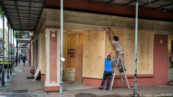 Gallery owners boarding up the gallery ahead of a storm (Kathleen Flynn/REUTERS)