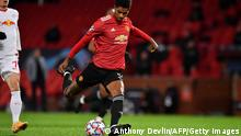 Manchester United's English striker Marcus Rashford scores his team's third goal during the UEFA Champions league group H football match between Manchester United and RB Leipzig at Old Trafford stadium in Manchester, north west England, on October 28, 2020. (Photo by Anthony Devlin / AFP) (Photo by ANTHONY DEVLIN/AFP via Getty Images)
