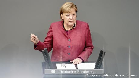 German Chancellor Angela Merkel speaks to the Bundestag in Berlin